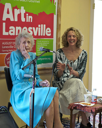 Barbara Erkkila cracks up Heather Atwood and the crowd as she recalls times from the past, at the Lanesville Community Center. Desi Smith Photo