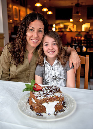 Melissa Sallah owner Suger Magnolia's on Main St, sits with her daughter Georgia Hart and the Georgia's Toast that was named after her.  Desi Smith/Gloucester Daily Times.
