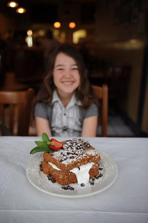 "Georgia Hart 7, sits behind the ""Georgia's Toast"" which is graham coated, marshmallow and chocolate stuffed French Toast, that was named after her.<br /> Desi Smith Photo"