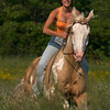Serina Barbara rides her horse through a field at Charlie Lane Stables. Desi Smith Photo