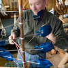Rockport: Jim Waddell works on a wind sculpture. He works out of a lobster shack in Pigeon Cove. Photo/Mary Muckenhoupt/Cape Ann Magazine