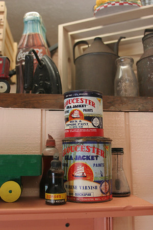 Old cans of paint from the Paint Factory are just some of the historic finds that decorate the walls of Tucker's Farm Family Diner.  Photo by Mary Muckenhoupt/Cape Ann Magazine