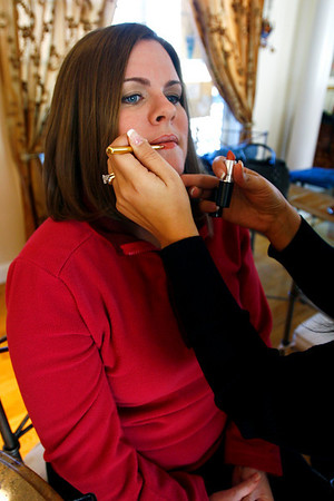 Rockport Police Officer Colleen Daniels get her make-up done by Felicia Trupiano of Rockport. Photo by Kate Glass/Cape Ann Magazine