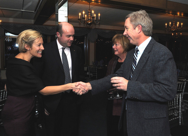 Barbara Tanger wife of Todd Tanger the new President of the Chamber, next to her, greets Richard Powers and his wife. M.J. Powers, at the Cape Ann Chamber of Commerce 87th Annual Dinner-Dance Saturday, January 24, 2009 at the Tavern on the Harbor.