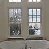 The master bath even takes advantage of the views, you can even see New Hampshire on the clearest day.  Photo by Mary Muckenhoupt/Cape Ann Magazine.