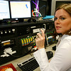 Rockport: Rockport Police Officer Colleen Daniels in the dispatch center at the Rockport Police Station. Photo by Kate Glass/Cape Ann Magazine