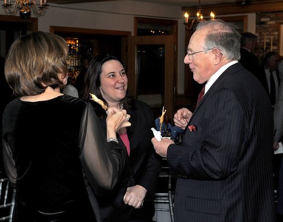 State Senator Ann-Margaret Ferrante talks with Bob Whitmarsh owner of Whitmarsh Lock and Safe, and his wife Dolores, at the Cape Ann Chamber of Commerce 87th Annual Dinner-Dance Saturday, January 24, 2009 at the Tavern on the Harbor.