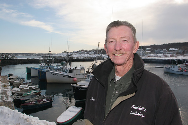 Rockport: Jim Waddell works on his sculputes in a lobster shack on Pigeon Wharf.. Photo/Mary Muckenhoupt/Cape Ann Magazine