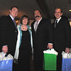 Left to right Robert Struss, Joan Wolkin, Tony Corrao, and Chris Murch. Joan presented the gifts to them at the Cape Ann Chamber of Commerce 87th Annual Dinner-Dance Saturday, January 24, 2009 at the Tavern on the Harbor.