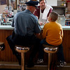 Tucker's Farm Family Diner: Rockport Police officer Dan Mahoney sits at the bar with his son Jason, 10. Photo by Mary Muckenhoupt/Cape Ann Magazine