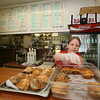Manchester: Kristin Gulbrandsen gets the muffins ready at the Beach Street Cafe. Photo by Kate Glass/Cape Ann Magazine