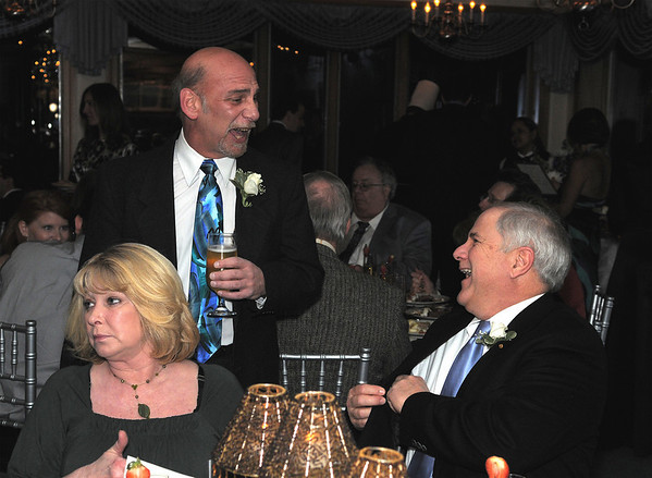 Out going Chamber President Steve Kaity and Brad Pierce owner of Cape Ann Motor Inn, enjoy a laugh together. Brad's wife Marilyn is setted on left, at the Cape Ann Chamber of Commerce 87th Annual Dinner-Dance Saturday, January 24, 2009 at the Tavern on the Harbor.
