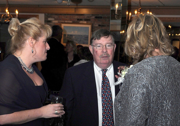 Mike Costello former Executive Director of the Chamber, talks with Kathy Ciluffo 1st Vice-President (left) and Sinikka Nogelo, host of the Cape Ann Cape Ann Report at the Chamber of Commerce 87th Annual Dinner-Dance Saturday, January 24, 2009 at the Tavern on the Harbor.