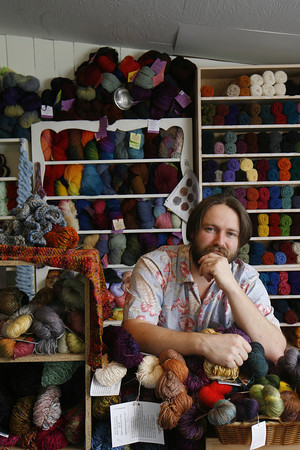 Roger Darrigrand/Cape Anne Magazine Rob Porter, owner of Coveted Yarn on E Main Street in Gloucester.