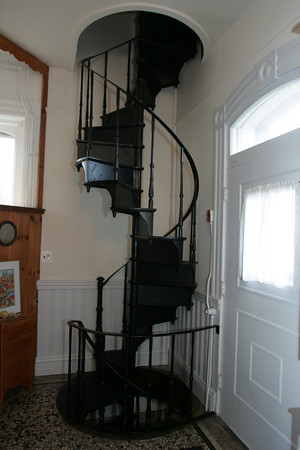 A wrought-iron staircase leads to the second floor. Photo by Mary Muckenhoupt