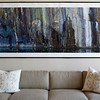 This photograph of granite from a local quarry by Leslie D. Bartlett hangs above the couch in Steel's condo. She selected it with the help of interior designer Suzanne Carver. The photo appealed to her because it reminds her of her families connection to local quaries -- her grandfather worked at Bayview Quarry. Photo by Amy Sweeney.