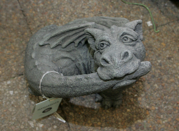 Keep your garden fierce this spring with this stone garden dragon accent, $99.98. Wolf Hill Garden Center, Gloucester.