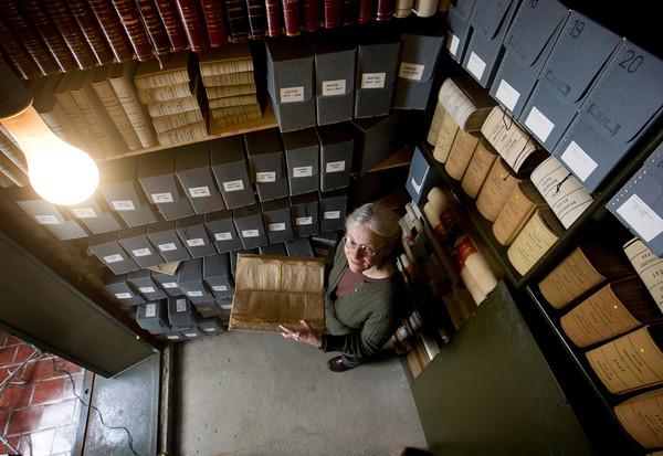 Roger Darrigrand/Cape Ann Magazine Goucester City Hall Archivist Susan Dunlap