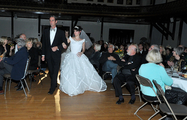 Tom Nihan escorts Elizabeth Bollenberg during the finale: Brides through the ages.<br /> <br /> Photo by Desi Smith.