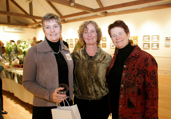"""Masterpieces in Miniature""  reception at the Rockport Art Association, November 20, 2009<br /> Lynda Wallock, Pam Stratton and Kathryn Tuck. Photo by Mary Muckenhoupt"