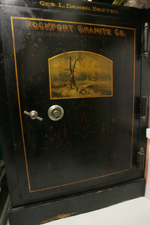 The original safe of the Rockport Granite Company still sits in the home of Kate Webster at 83 Granite Street. The safe has two landscapes paintings, a winter scene on the outside, shown here, and a summer scene on the inside. Photo by Mary Muckenhoupt