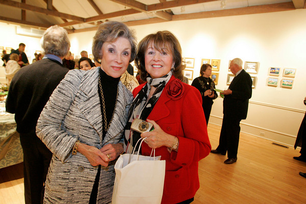"""Masterpieces in Miniature""  reception at the Rockport Art Association, November 20, 2009<br /> Patricia Lambert and Nancy Strisik. Photo by Mary Muckenhoupt"