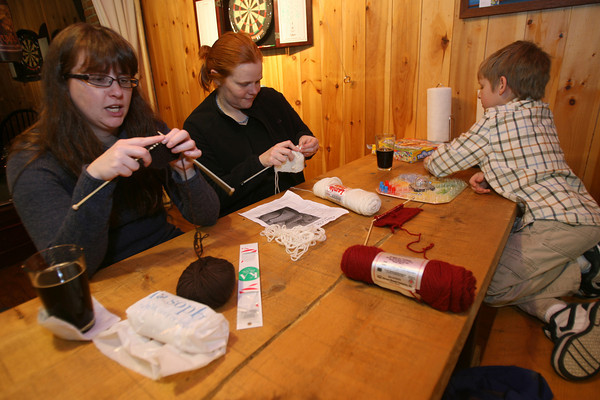 Nikki Leavitt, Dawn Enos and her son, Jacob Enos, 8, knitting at the Cape Ann Brewery. Photo by Kate Glass