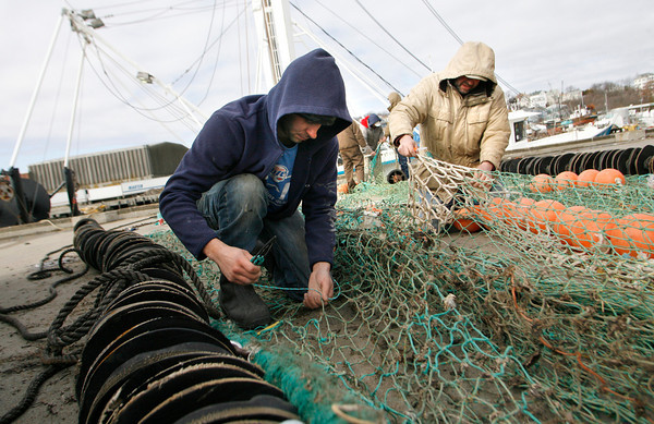 Gloucester: Tom Testaverde Jr., left, and Tom Testaverde work on the nets for the Midnight Sun at the Jodrey State Fish Pier yesterday. The crew is changing the nets as they shift from catching squid to groundfishing. Photo by Kate Glass/Gloucester Daily Times Monday, February 16, 2009<br /> , Gloucester: Tom Testaverde Jr., left, and Tom Testaverde work on the nets for the Midnight Sun at the Jodrey State Fish Pier yesterday. The crew is changing the nets as they shift from catching squid to groundfishing. Photo by Kate Glass/Gloucester Daily Times Monday, February 16, 2009