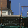 Gloucester: Workers removed the scaffolding around the tower of City Hall Friday morning. Photo by Mary Muckenhoupt