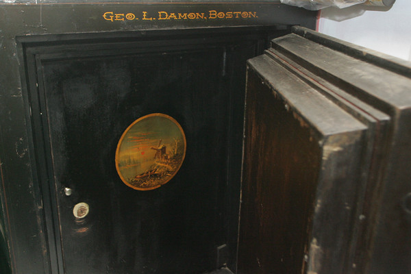 The original safe of the Rockport Granite Company still sits in the home of Kate Webster at 83 Granite Street. The safe has two landscapes paintings, a winter scene on the outside and a summer scene, as shown here, on the inside. Photo by Mary Muckenhoupt