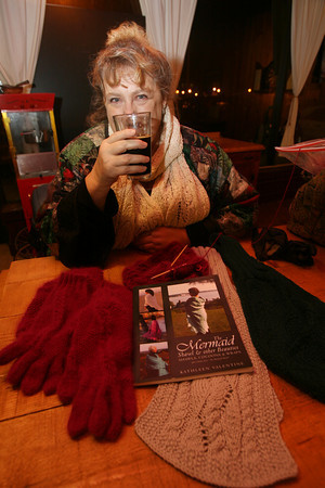 Kathleen Valentine knitting at the Cape Ann Brewery. Photo by Kate Glass