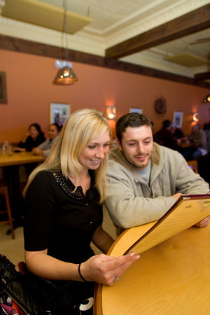 Kendra McGrath and Mark Deleary look over a menu at Jalapenos Restaurant located at 86 Main Street, Gloucester. Photo by Mary Muckenhoupt.