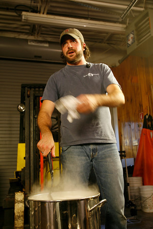T.J. Peckham stirs the wort.<br />  Photo by Kate Glass