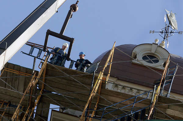 Gloucester: Workers begin removing the scaffolding around City Hall Friday morning.    Photo by Mary Muckenhoupt