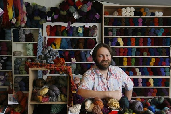 Roger Darrigrand/Cape Ann Magazine Rob Porter, owner of Coveted Yarn on E Main Street in Gloucester.