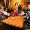 Kathleen Valentine, Donna Demarkis, and Leslie Wind knitting at the Cape Ann Brewery. Photo by Kate Glass