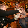 Toni Ramos gives Dylan L'Abbe-Lindquist a few pointers as he knits at the Cape Ann Brewery. Photo by Kate Glass