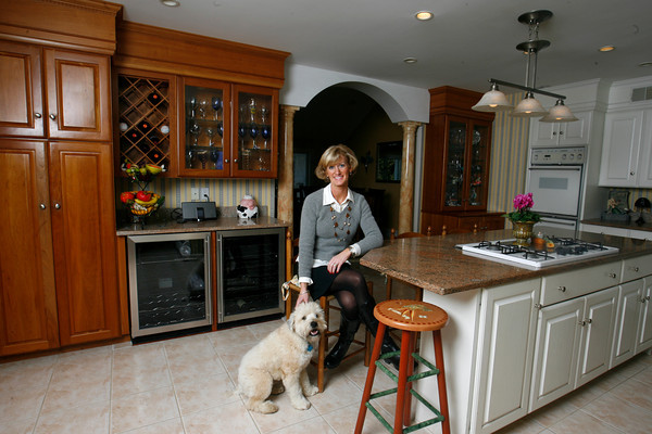 Home owner Marne Malloy in the kitchen with Q, the family dog.  Photo by Roger Darrigrand