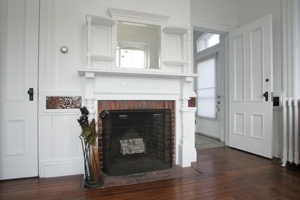 The original fireplace opposite a window that overlooks Granite Pier in Kate Webster's home on 83 Granite Street. Photo by Mary Muckenhoupt