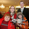 Lobstertrap Tree Buoy Auction at Cruiseport January 29, 2010<br /> From left, Brad Chamberlain, 10, Chloe Flavin, 12, David Brooks, back, and Max Flavin, 10. Photo by Mary Muckenhoupt