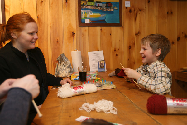 Dawn Enos and her son, Jacob, 8, knitting at the Cape Ann Brewery. Photo by Kate Glass