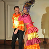 "David Adams, left, and Dale Theberge,  perform Carmen Miranda's "" I like you very Much.""  <br /> Bananas Fashion show to help restore Gloucester City Hall. Photo by Desi Smith"