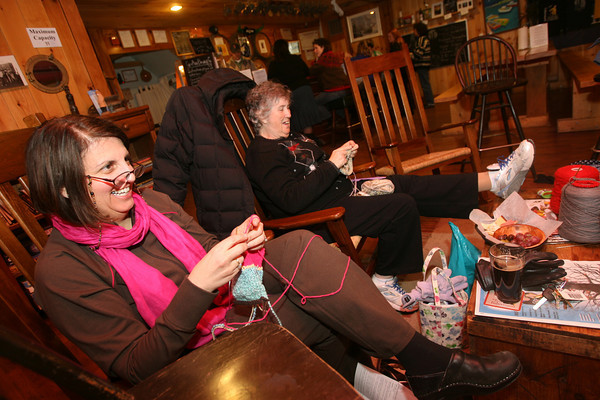Pat Hand and Toni Ramos knitting at the Cape Ann Brewery. Photo by Kate Glass