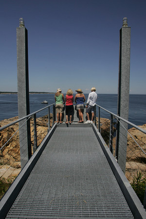 Seaside Gardens Tour 2009: From left, Kris Munroe, Beverly LaCombe, Kelly Arsenian and Audrey Coughlin look out onto the Atlantic form the gang plank behind the home of Richard Tadler during the Rockport Seaside Gardens Tour last summer. The Rockport Seaside Garden's Tour is presented by the Rockport Garden Club. Photo by Mary Muckenhoupt
