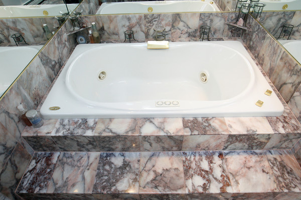 The master bath was transformed from a pink and brass theme and is complete with a jacuzzi.  Photo by Roger Darrigrand