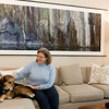 Downtown living appealed to Gloucester native June Steel, shown here with her daughter's dog Daisy. The Gloucester High graduate has created a neutral oasis to show off her favorite artwork and collectibles. Photo by Amy Sweeney.