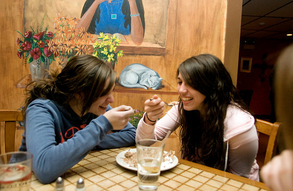 Hannah Sperry, left, and Courtney Smith share fried ice-cream at Jalapenos Restaurant located at 86 Main Street, Gloucester. Photo by Mary Muckenhoupt.