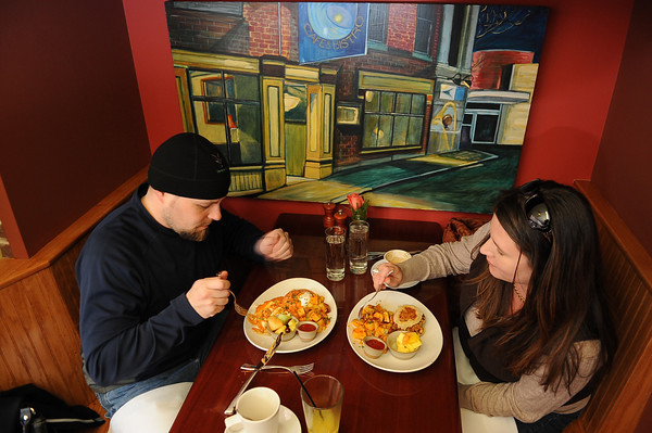 Scott and Kelly Dallaire from New Market NH have the Lobster eggs Benedict. The couple found out about Alchemy's on the Phantom Website.<br /> Photo by Desi Smith/