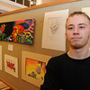 Gloucester: Cole Herbst a student artist at Art Haven,stands next to his art work that he displayed at Cruiseport ,for Art Haven's Buoy silent auction.  Desi Smith/Gloucester Daily Times.