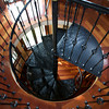 The winding staircase leads to a rooftop view of Rockport Harbor. Peter and Julie Fariel turned a simple summer cottage on Norwood Ave in Rockport into an elegant year-round home.<br /> Photo by Kate Glass.